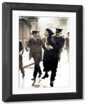 EMMELINE PANKHURST  (1858-1928). English woman-suffrage advocate. Mrs. Pankhurst arrested outside Buckingham Palace, London, while trying to present a petition to King George V, 21 May 1914
