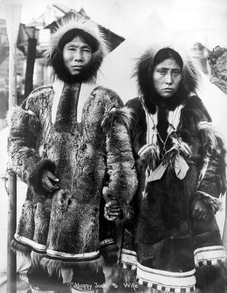"ALASKA: ESKIMO COUPLE.   An Eskimo man and woman identified as ""Happy Jack"" and wife, in traditional dress, Alaska. Photographed by Frank H. Nowell, October 1904"