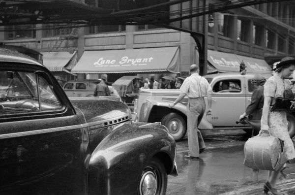 CHICAGO: TRAFFIC, 1941.   Jaywalkers in traffic in Chicago, Illinois. Photograph by John Vachon, July 1941