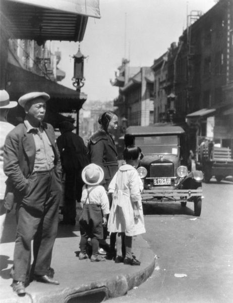 CHINESE IMMIGRANTS.   A street scene in San Francisco's Chinatown. Photograph, c1920, by Arnold Genthe