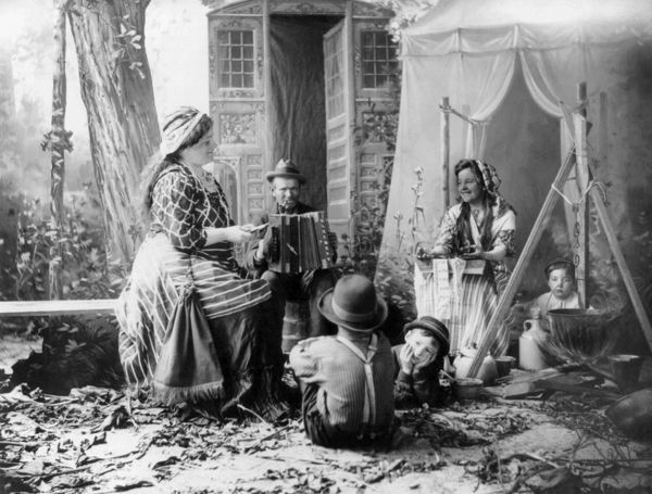 GYPSYIES, c1902.   'Happy Romanies.' A staged rendition of musicians in a gypsy camp. Photographed c1902