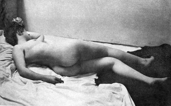 RECLINING NUDE, 1902. 'A Noonday Nap.' Nude study, 1902, by the St