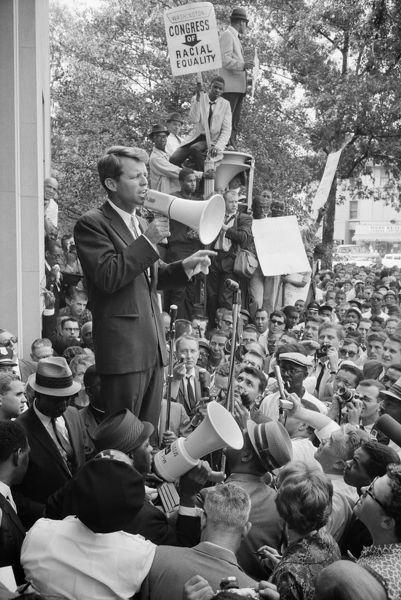 ROBERT F. KENNEDY (1925-1968). American lawyer and politician. Kennedy, while Attorney General, speaking at a demonstration by the Congress of Racial Equality outside the Justice Department in Washington, D.C. Photograph by Warren K. Leffler, 14 June 1963