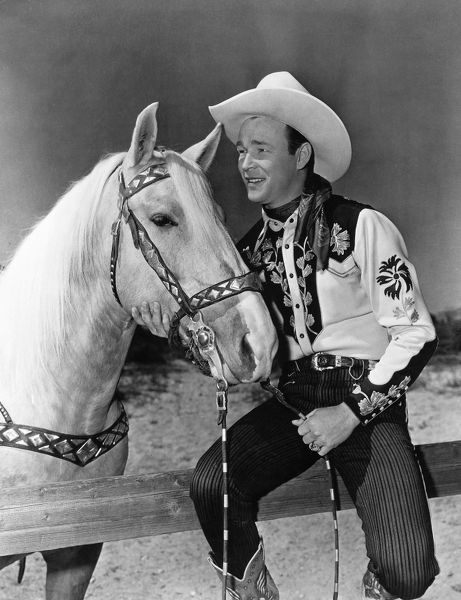 ROY ROGERS (1912-1998). © Leonard Slye. American singing cowboy actor. Photographed with his horse Trigger