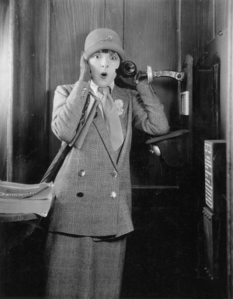 TELEPHONE BOOTH, 1920s.  Colleen Moore in a 1920s silent movie still