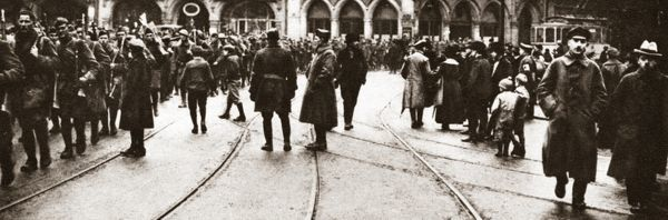 WORLD WAR I: OCCUPATION.   American troops marching through the Kaiser Platz in Treves, Germany. Photograph, December 1918
