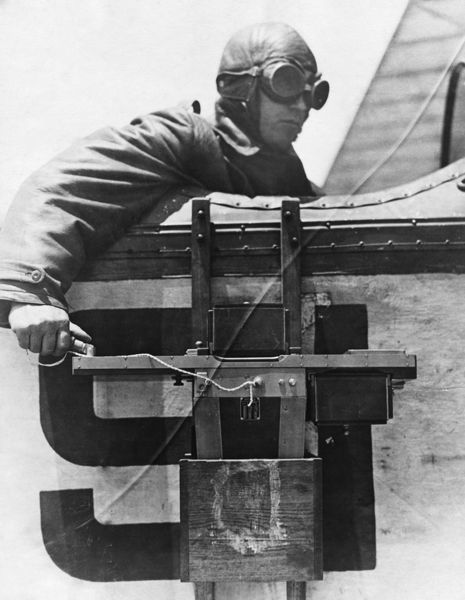WORLD WAR I: PHOTOGRAPHER, c1917. A photographer with camera apparatus, seated in an open-topped aircraft. Photograph, 1917 or 1918