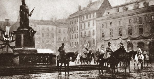 WORLD WAR I: REVIEW, c1919. Marshal Foch with Generals Castelnau and Fayolle on horseback reviewing lines of French troops passing through Strasbourg, France. Photograph, c1919