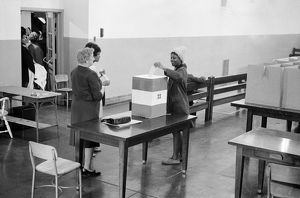 american elections/african american voter casting vote polling station