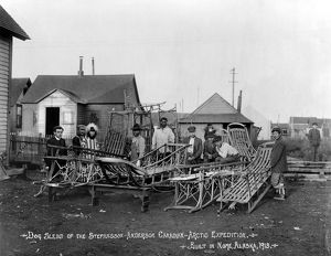 ALASKA: DOG SLEDS, c1913. A group of Eskimo men and a Caucausian clergyman standing