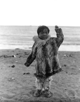 ALASKA: ESKIMO CHILD. A young Eskimo boy playing on the beach, Alaska