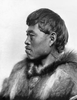 ALASKA: ESKIMO MAN, c1916. Eskimo man in profile wearing a fur coat, Nome, Alaska