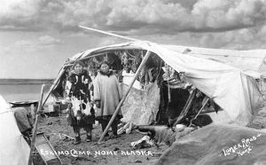 ALASKA: ESKIMOS, c1916. Two Eskimo women standing in front of a tent in their camp in Nome