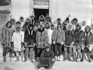 ALASKA: ESKIMOS, c1916. A group of Eskimo men outside of a building, Kivalina, Alaska