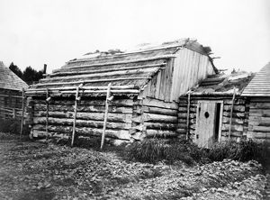 ALASKA: LOG CABIN, c1899. Log cabins in Kodiak, Alaska. Photograph by Edward Curtis