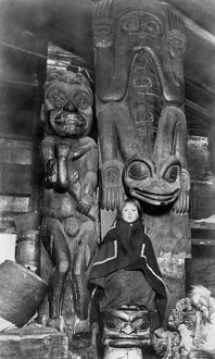 ALASKA: TOTEM POLES, c1895. Three old totem poles inside the house of a chief