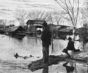 ARIZONA: FLOOD, 1891. Men observing the damage from the shore of the Salt River in Phoenix