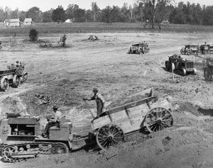ARKANSAS: LEVEES, 1922. Construction of levees using tractor-drawn wagons near Wyanoke