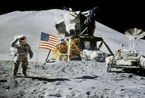 Astronaut Jim Irwin saluting the American flag by the lunar rover and the lunar module