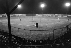 BASEBALL GAME, 1939. A night baseball game in Marshall, Texas. Photograph by Russell Lee