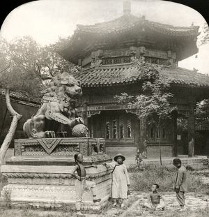 Bronze lion in the courtyard of the Lama Temple at Peking (Beijing), China. Stereograph
