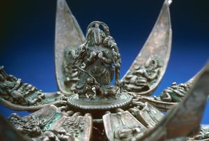 A bronze lotus with Buddhist divinities on the petals. Devotional object, Indian