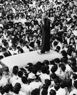 A Buddhist leader addressing a crowd of supporters from the top of a car in Saigon