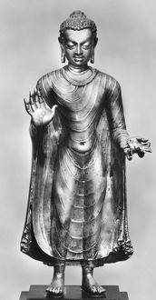 (c563-c483 B.C.). Indian philosopher, founder of Buddhism. Standing bronze figure of Buddha