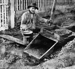 CALIFORNIA: MINING, c1866. A miner at work in Columbia, Tuolumne County, California