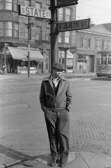 CHICAGO: MAN, 1941. Portrait of an African American man on the corner of State Street