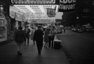 whats new/chicago 1941 pedestrians street outside theatre