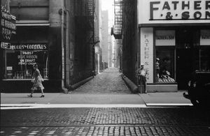 CHICAGO: ALLEY, 1940. View down an alley in Chicago, Illinois. Photograph by John Vachon