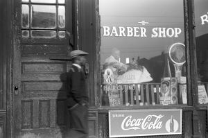 CHICAGO: BARBER SHOP, 1941. A barbershop in the Black Belt section of Chicago, Illinois