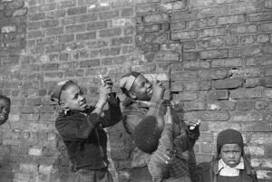 CHICAGO: CHILDREN, 1941. Boys playing and pretending that they are shooting machine