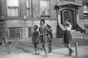CHICAGO: CHILDREN, 1941. Children jumping rope outside of an apartment building
