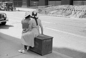 CHICAGO: COMMUTERS, 1940. Two women waiting for a street car in Chicago, Illinois