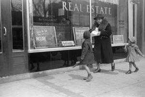 CHICAGO: FAMILY, 1941. An African American family in front of a real estate office