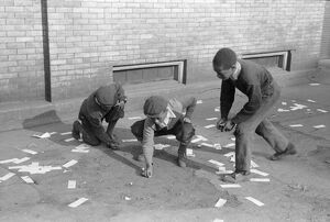 CHICAGO: MARBLES, 1941. A group of African American boys playing marbles outside