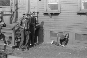 CHICAGO: MARBLES, 1941. A group of people observing a game of marbles in Chicago, Illinois