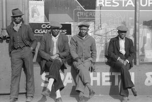CHICAGO: MEN, 1941. Group of African American men in front of a storefront in Chicago