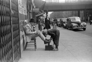 CHICAGO: SHOESHINE, 1941. A shoeshine on 47th Street on the South Side of Chicago