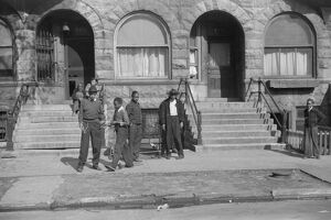 CHICAGO: STREET SCENE, 1941. Group of people outside of an apartment building