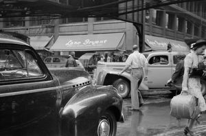 CHICAGO: TRAFFIC, 1941. Jaywalkers in traffic in Chicago, Illinois
