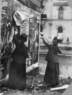 CINCINNATI: SUFFRAGETTES. Suffragettes Louise Hall and Susan Fitzgerald pasting