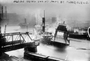 CLEVELAND: FLOOD, c1913. A bridge being swept away during a flood in Cleveland, Ohio