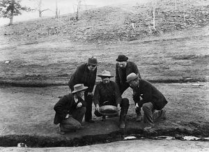 COLORADO: GOLD MINING, 1891. A group of men watching a placer miner panning for
