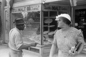 COLUMBUS: STREET, 1938. Conversation on the streets of Columbus, Ohio
