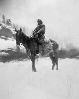 CURTIS: SCOUT, 1908. The scout in winter. Photographed by Edward S. Curtis, 1908.