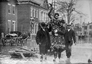 DAYTON FLOOD, 1913. Rescue workers carrying a woman after the flood in Dayton, Ohio