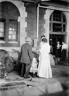 ELLIS ISLAND, 1917. A new immigrant family at Ellis Island. Photograph, March 1917